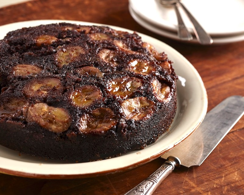 Chocolate Banana Upside Down Cake on a Plate with a Cake Server on the Side