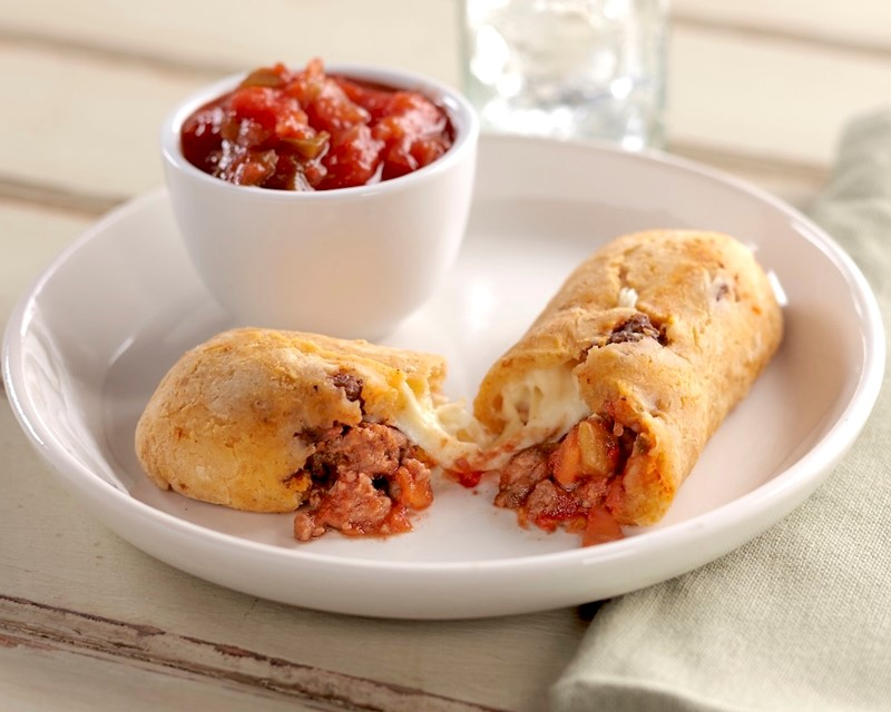 Gluten-Free Taco-Stuffed Bread Sticks Split open with a Cup of Salsa on the Side
