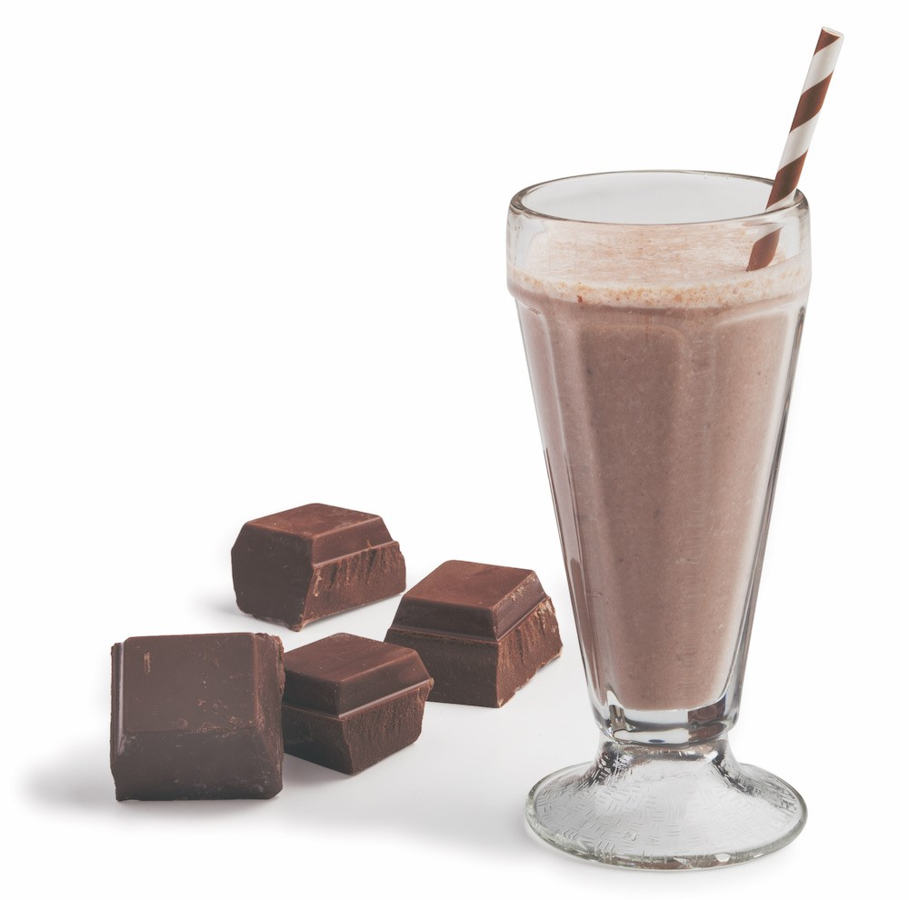 Chocolate Pieces next to a Chocolate Shake with a Striped Straw