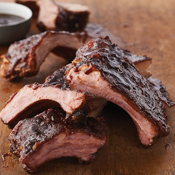 Baby Back Ribs with Barbecue Sauce on Wood Surface