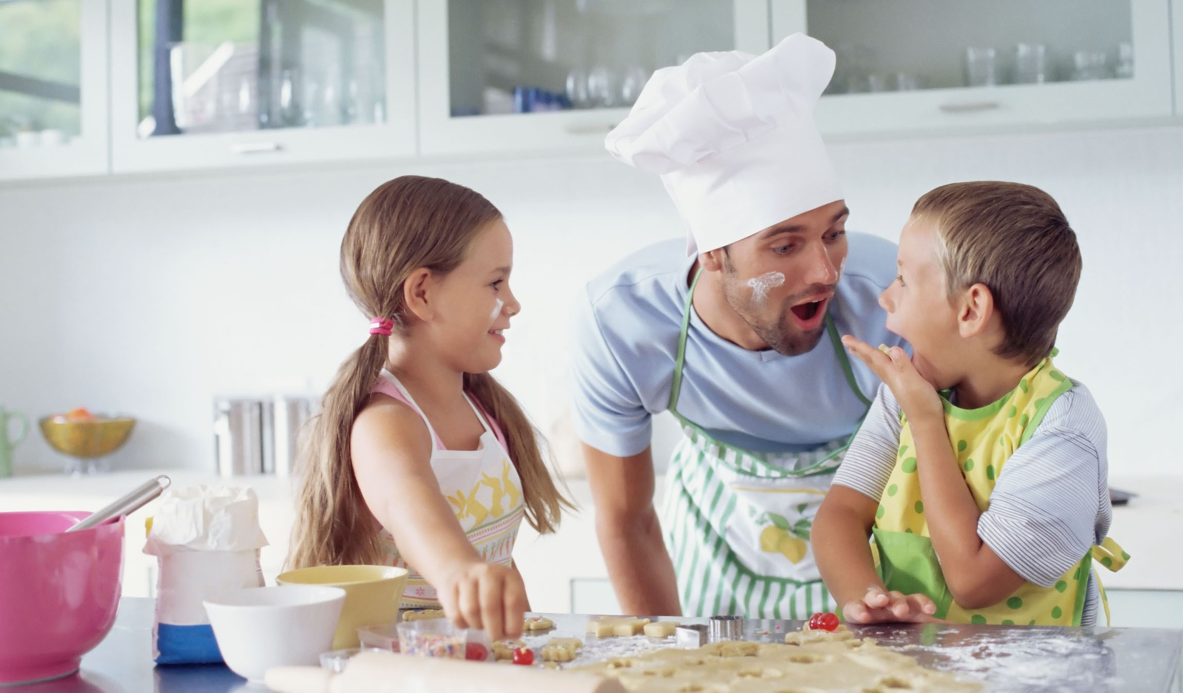 Children in Kitchen with Father