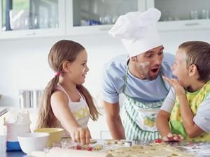 Children in Kitchen with Father