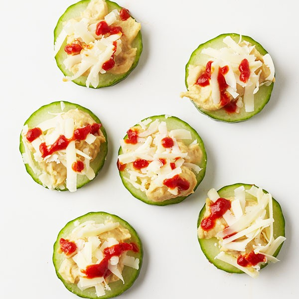 Cucumber Slices with Hummus, Cheese, and Sriracha