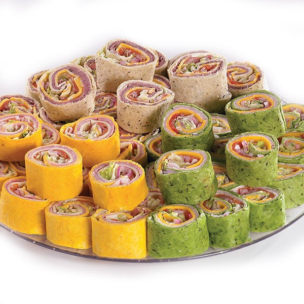 Assorted deli roll-ups wrapped in colorful flour tortillas