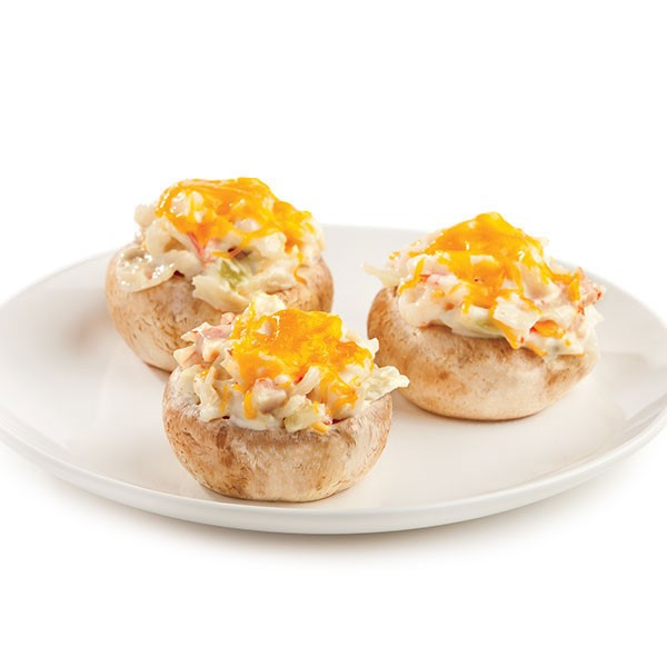 Plate of Imitation Crab Stuffed Mushrooms with Melted Yellow Cheese on Top