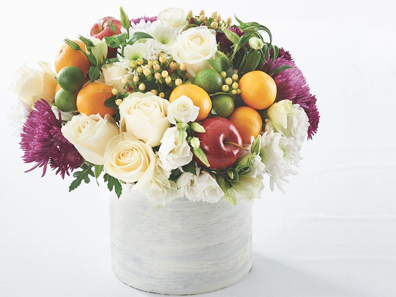 Flowers in Pot with Whole Limes, Whole Oranges, and Whole Red Apples