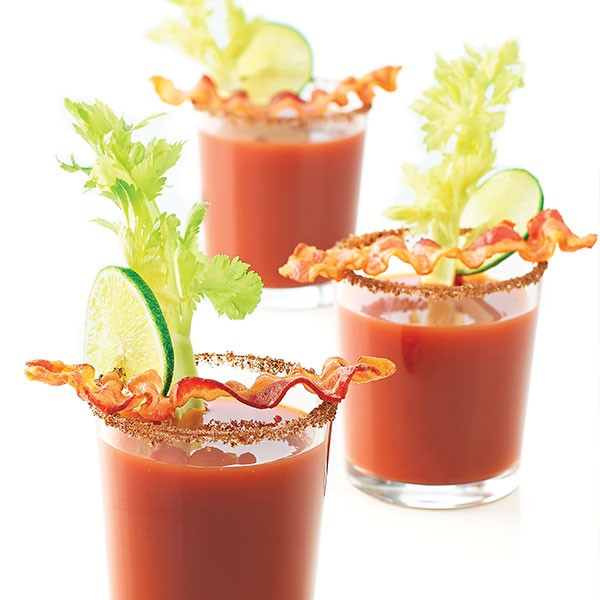 Bloody Marry topped with Lime Slice, Bacon, and Celery
