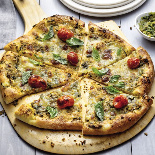 Pizza topped with Pesto, Basil Leaves, and Tomatoes