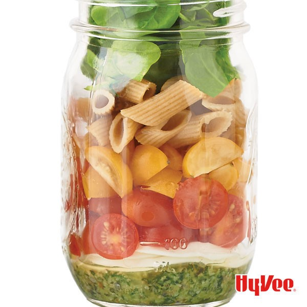 Caprese Pint Jar Salad with Pesto, Tomatoes, Spinach, and Whole Grain Pasta