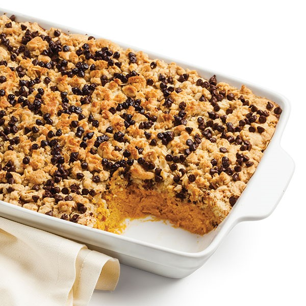 9x13 baking dish with a serving missing and mini chocolate chips on top