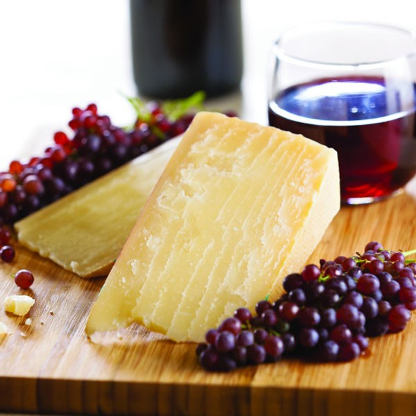 Cheese Board with Red Wine in Glass and Grapes