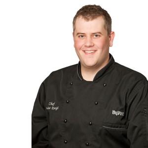 Chef Andrew in black Hy-Vee chef's coat