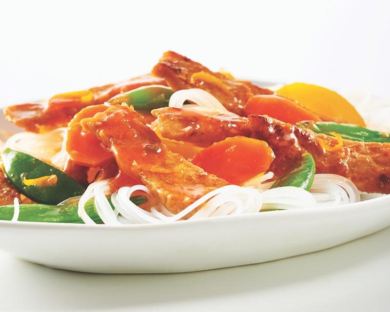 Orange-ginger pork stir-fry over noodles