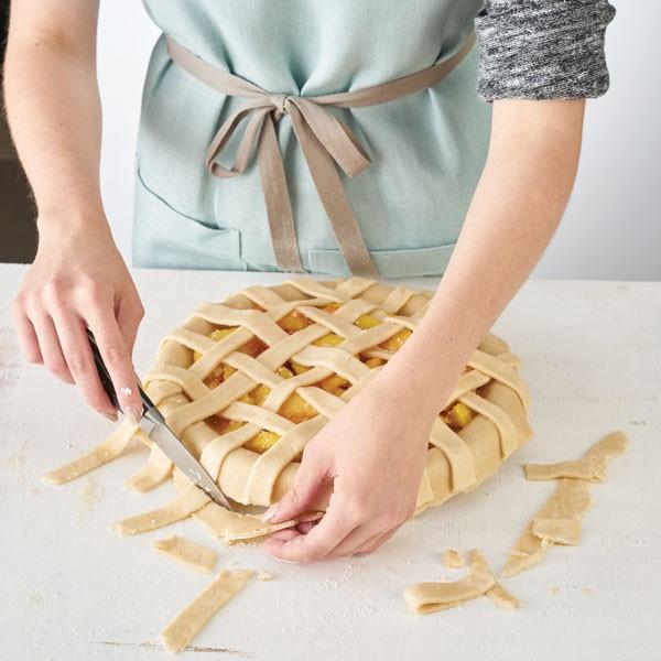 Trimming excess pie crust from lattice top crust