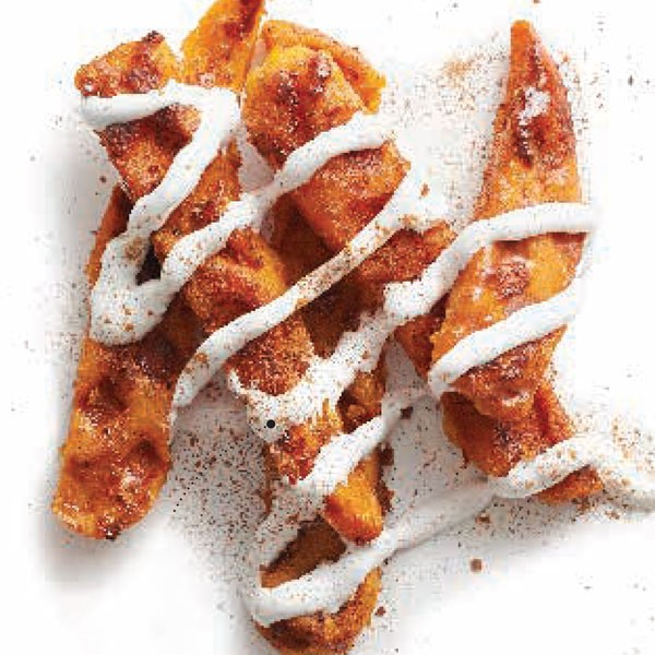 Sweet potato steak fries covered in cinnamon-syrup sauce and piped with melted marshmallow crème
