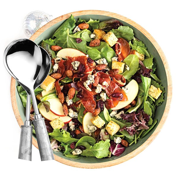 Hearty apple salad with cheese, croutons, cranberries, and crisped prosciutto