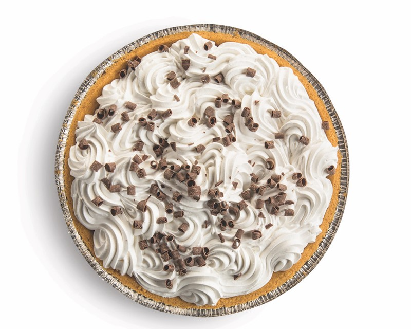 whole french silk pie covered in whipped cream and chocolate curls