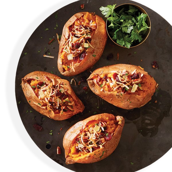 Four Stuffed Sweet Potoatoes served with a side of Cilantro