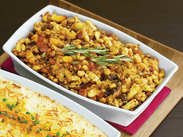 Dish of stuffing, garnished with rosemary sprigs