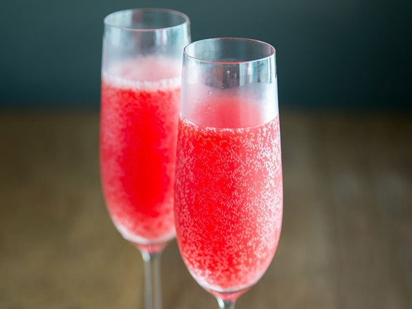 Two glasses of red bubbly champagne cocktail