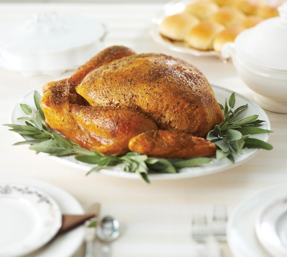 roast turkey on a platter with sage leaves