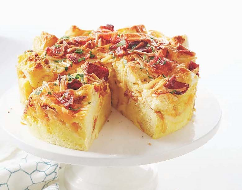 bacon and cheese strata on a cake stand