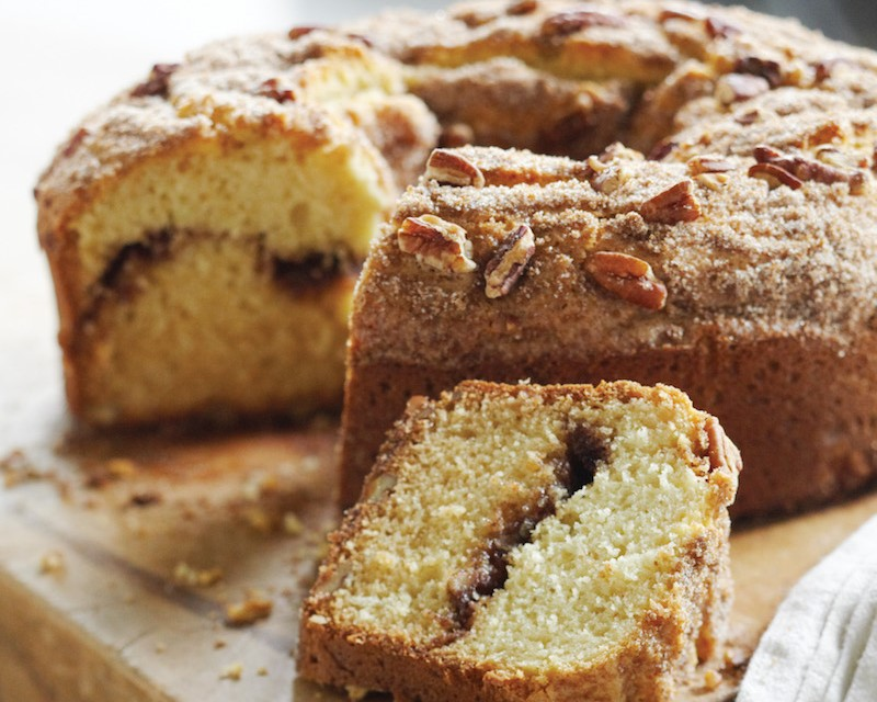 Coffee cake with a cinnamon-sugar filling and topped with cinnamon, sugar and pecans