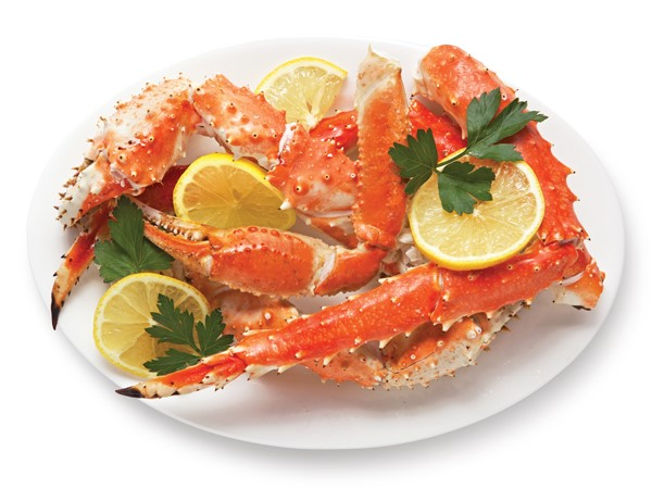 Plate of crab legs garnished with lemon slices