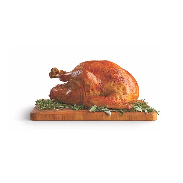 whole turkey on a carving board