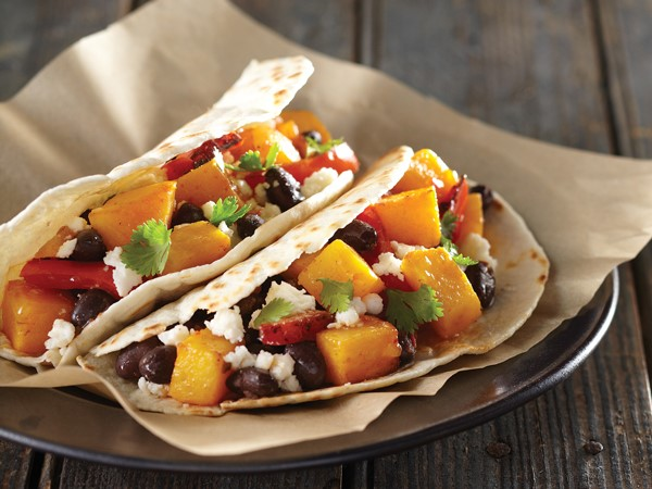 Whole wheat flour tortillas filled with squash, black beans, red bell peppers, fresco cheese and cilantro